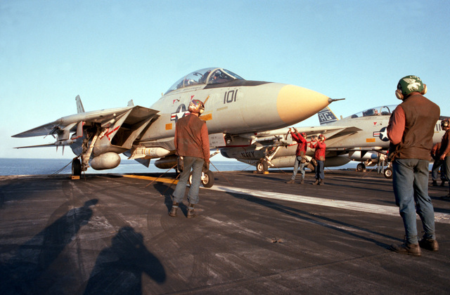 A Fighter Squadron 143 (VF-143) F-14A Tomcat aircraft is readied for launch from the flight deck of the nuclear-powered aircraft carrier USS DWIGHT D. EISENHOWER (CVN 69)