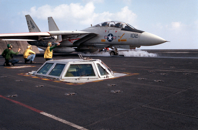A Fighter Squadron 143 (VF-143) F-14A Tomcat aircraft is ready for launch from the No. 2 catapult on the flight deck of the nuclear-powered aircraft carrier USS DWIGHT D. EISENHOWER (CVN 69)