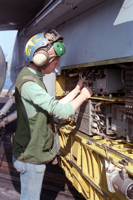 A maintenance crew member of Attack Squadron 66 (VA-66) conducts a preflight check of one of the squadron's A-7E Corsair II aircraft aboard the nuclear-powered aircraft carrier USS DWIGHT D. EISENHOWER (CVN 69)