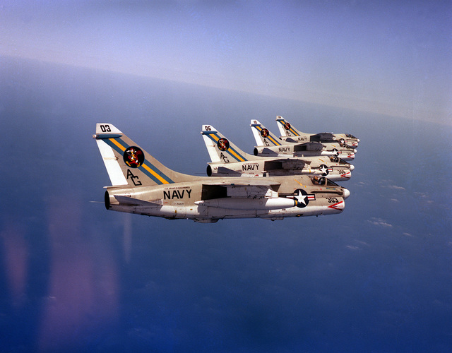 An air-to-air view of four A-7E Corsair II aircraft of Attack Squadron 66 (VA-66) in formation
