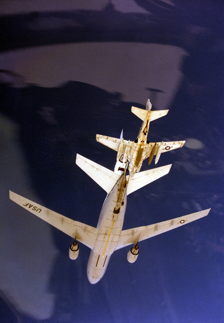 An underside view of an Air Force KC-10A Extender aircraft refueling a KA-6D Intruder aircraft of Attack Squadron 65 (VA-65) during exercise Bright Star '83