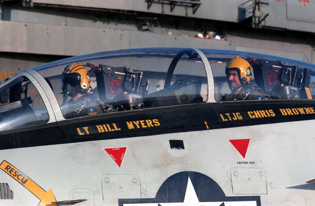 Lieutenant Bill Myers and his radar intercept officer await the launch of their Fighter Squadron 142 (VF-142) F-14A Tomcat aircraft from the flight deck of the nuclear-powered aircraft carrier USS DWIGHT D. EISENHOWER (CVN 69)