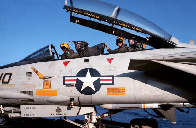 Lieutenant Keith Gauthier performs a preflight check on his Fighter Squadron 142 (VF-142) F-14A Tomcat aircraft prior to taking off from the flight deck of the nuclear-powered aircraft carrier USS DWIGHT D. EISENHOWER (CVN 69)