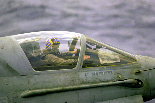LT. Ben. Powers prepares for a late evening launch in the cockpit of his Attack Squadron 66 (VA-66) A-7E Corsair II aircraft on the flight deck of the nuclear-powered aircraft carrier USS DWIGHT D. EISENHOWER (CVN-69)