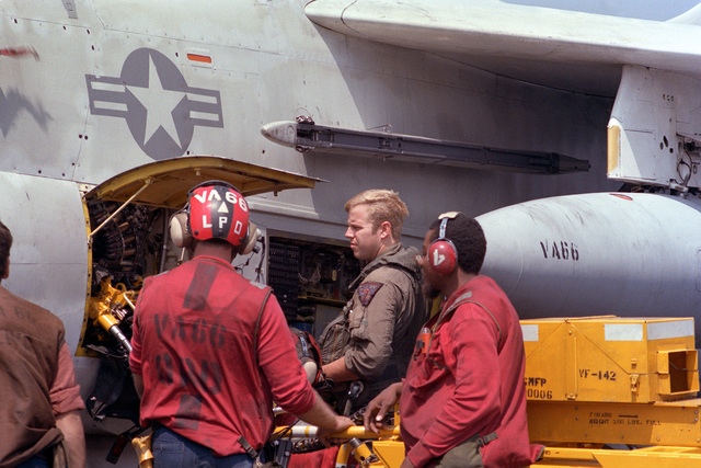 Maintenance crew members of Attack Squadron 66 (VA-66) and the pilot conduct a preflight check of one of the squadron's A-7E Corsair II aircraft aboard the nuclear-powered aircraft carrier USS DWIGHT D. EISENHOWER (CVN 69)