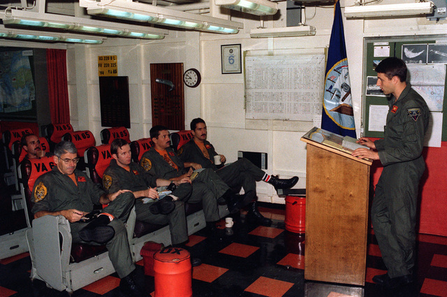 Members of Attack Squadron 65 (VA-65) attend a preflight briefing in the squadron ready room aboard the nuclear-powered aircraft carrier USS DWIGHT D. EISENHOWER (CVN-69)