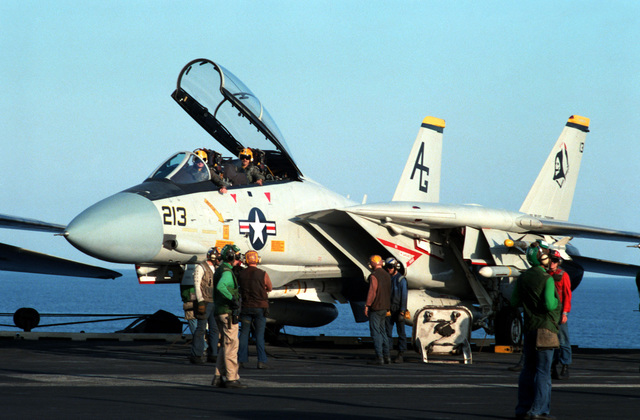 Squadron maintenance personnel perform a preflight check on a Fighter Squadron 142 (VF-142) F-14A Tomcat aircraft prior to its launch from the nuclear-powered aircraft carrier USS DWIGHT D. EISENHOWER (CVN 69)