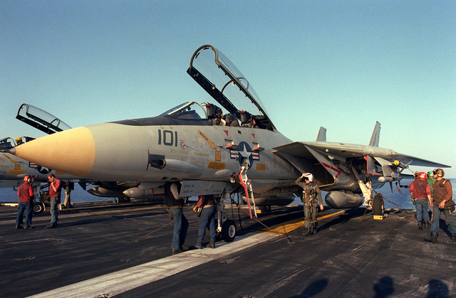 Squadron maintenance personnel perform a preflight check on a Fighter Squadron 143 (VF-143) F-14A Tomcat aircraft prior to its launch from the nuclear-powered aircraft carrier USS DWIGHT D. EISENHOWER (CVN-69)