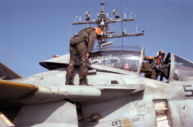 The pilot and bombardier-navigator of an Attack Squadron 65 (VA-65) A-6E Intruder aircraft conduct a preflight check of their aircraft on the flight deck of the nuclear-powered aircraft carrier USS DWIGHT D. EISENHOWER (CVN 69)