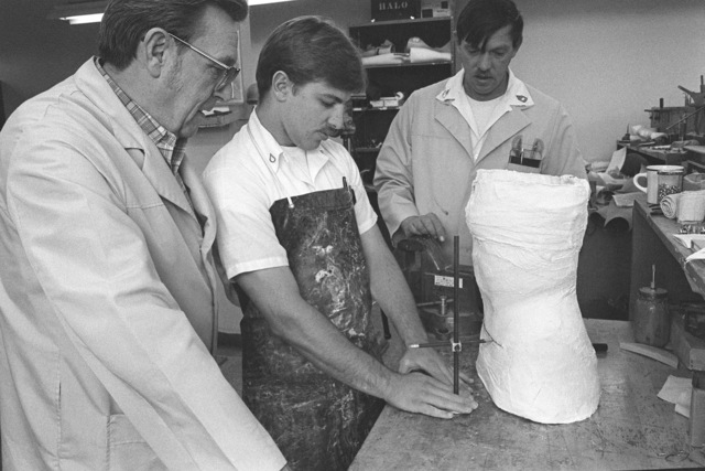 From left to right, Mr. Lester Cupp, Private Jim Roysdon and Sergeant First Class Walter Grogan, as they modify a Milwaukee brace mold in the Leg and Brace Shop at Letterman Army Medical Center