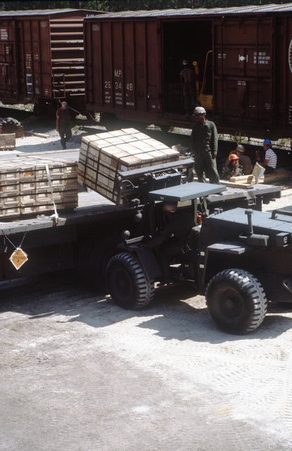 A Case M4K forklift truck is used to load a pallet onto a flatbed truck during LIFELINE Operations. The operations are being conducted by the 155th, 567th and 870th Transportation companies