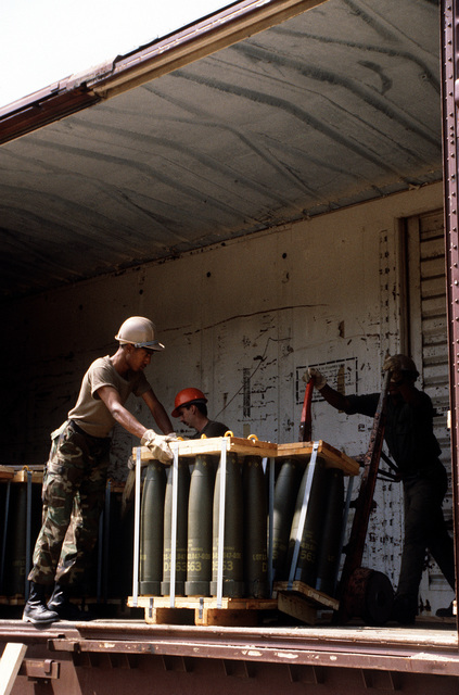 A Case M4K forklift truck is used to place pallets on a flatbed truck while an RT4000 forklift unloads a railroad car during LIFELINE Operations. The operations are being conducted by the 155th, 567th and 870th Transportation companies