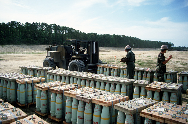 A Case M4K rough terrain forklift is used to move a pallet of 155 mm shells during LIFELINE Operations. The operations are being conducted by the 155th, 567th and 870th Transportation companies