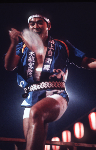 A Japanese dancer participates in the annual community folk dancing ceremony known as Bon Odori. The dancing is one feature of the Obon services, which are similar to a Western-style All Soul's Day or Halloween. All Hands - May 1983