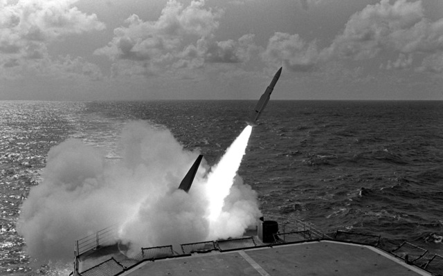 A RIM-66 Standard-MR/SM2 (medium range) missile is launched from the Mark 26 launcher aboard the Aegis guided missile cruiser USS TICONDEROGA (CG-47)