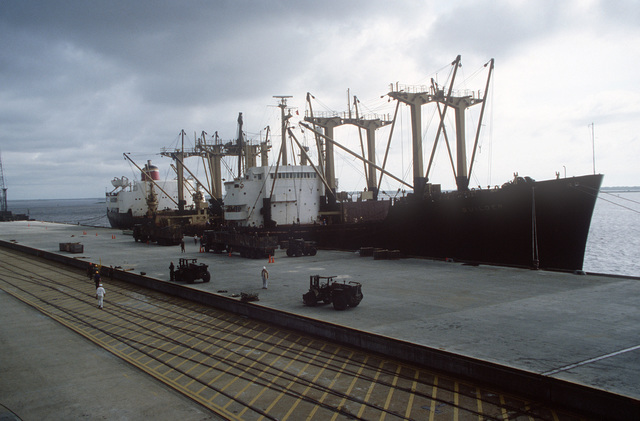 A starboard bow view of the chartered Military Sealift Command cargo ship BUILDER (T-AK 2031) used to transport cargo during LIFELINE Operations. The operations are being conducted by the 155th, 567th and 870th Transportation companies