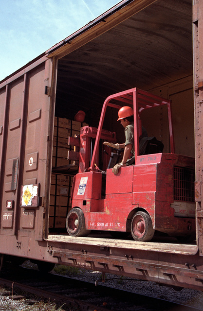 Ammunition is offloaded from a railcar with the use of a forklift during Lifeline operations conducted by the 155th, 567th and 870th Transportation Companies