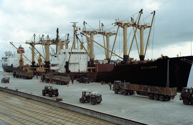 Ammunition is offloaded from the cargo ship BUILDER during LIFELINE operations conducted by the 155th, 567th and 870th Transportation Companies