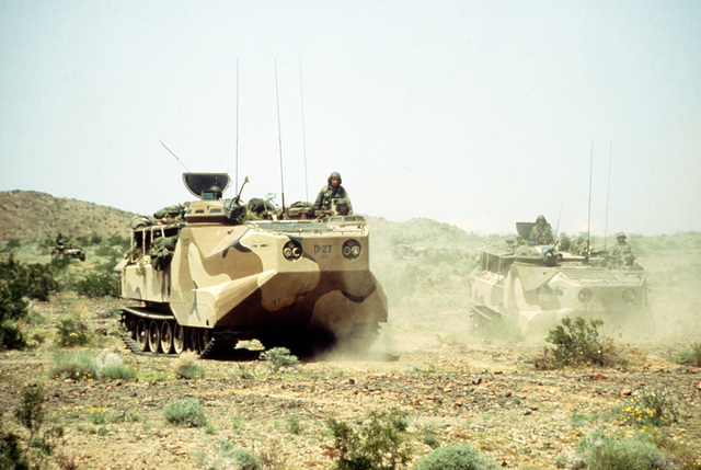 "Amphibious tracked vehicles attached to the Second Tank Battalion maneuver to attack an ""enemy"" position during Combined Arms exercises Five and Six"