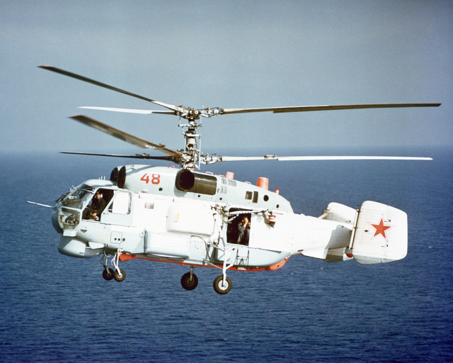 An air to air left side view of a Soviet Ka-27 Helix anti-submarine helicopter