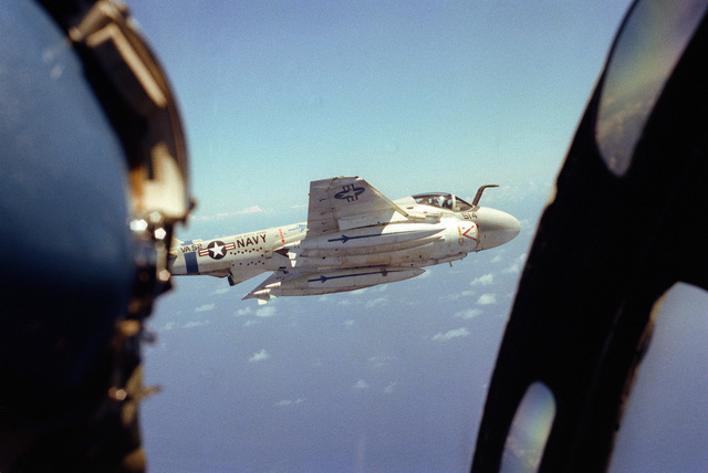 An air-to-air view of a KA-6D Intruder tanker aircraft from Attack Squadron 52 (VA-52) assigned to the aircraft carrier USS KITTY HAWK (CV 63). The refueling drogue housing is visible under the after fuselage
