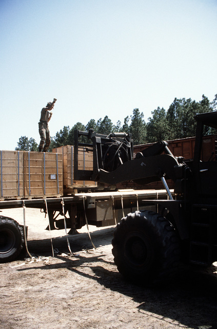 An RT4000 forklift is used to place boxes onto a flatbed truck during LIFELINE Operations. The operations are being conducted by the 155th, 567th and 870th Transportation companies