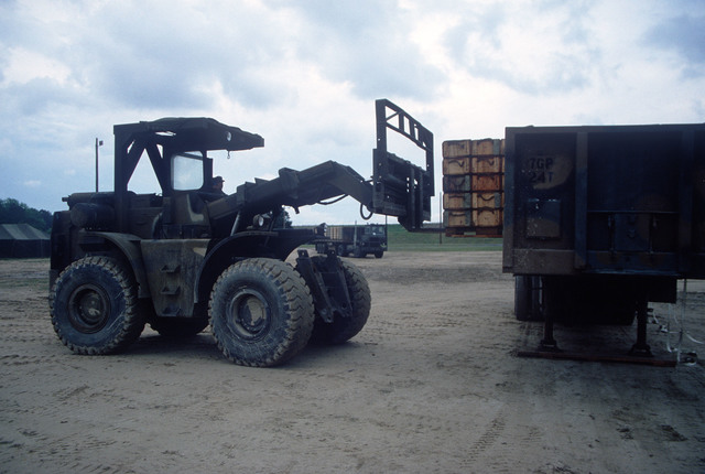 An RT4000 forklift is used to unload a pallet of ammunition from a truck during LIFELINE Operations. The 155th, 526th and 870th Transportation companies are conducting the operation