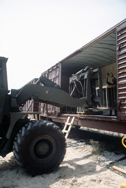 An RT4000 forklift is used to unload a pallet of shells from a railroad car during LIFELINE Operations. The operations are being conducted by the 155th, 567th and 870th Transportation companies