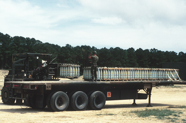 An RT4000 forklift is used to unload shells from an M872 trailer during LIFELINE Operations. The operations are being conducted by the 155th, 567th and 870th Transportation companies