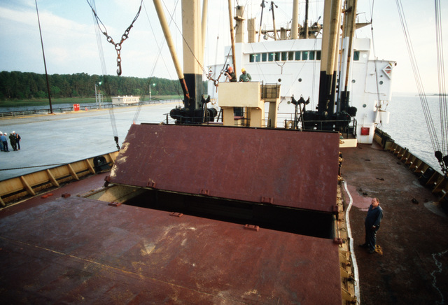 Hatches of the chartered Military Sealift Command cargo ship BUILDER (T-AK 2031) are opened for unloading as part of the LIFELINE Operations. The operations are being conducted by the 155th, 567th and 870th Transportation companies