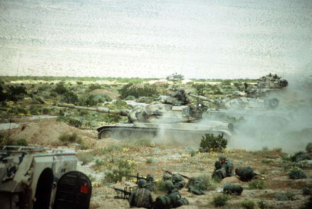 Marines of Lima Company, 3rd Battalion, 4th Regiment, supported by M-60 tanks, form a defensive line during Combined Arms exercises Five and Six