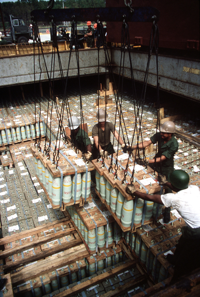 Members of 155th Transportation Company use a winch to unload a pallet of 155mm shells from the chartered Military Sealift Command cargo ship BUILDER (T-AK-2031) during lifeline operations