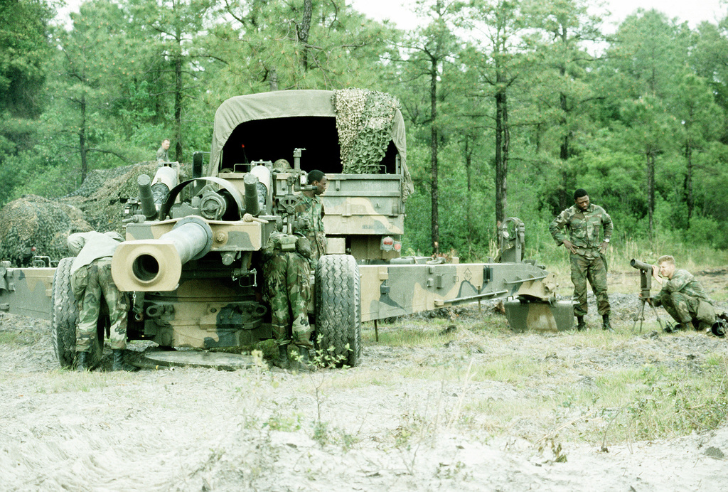 Members of the 10th Marine Regiment position an XM-198 155mm howitzer at Tactical Landing Zone Cardinal during Exercise Solid Shield '83