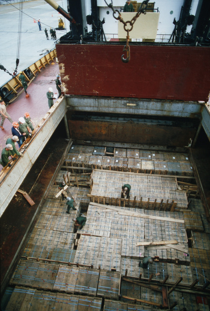 Members of the 155th Transportation Company prepare pallets of shells for unloading from the chartered Military Sealift Command cargo ship BUILDER (T-AK 2031) during LIFELINE Operations. The operations are being conducted by the 155th, 567th and 870th Transportation companies