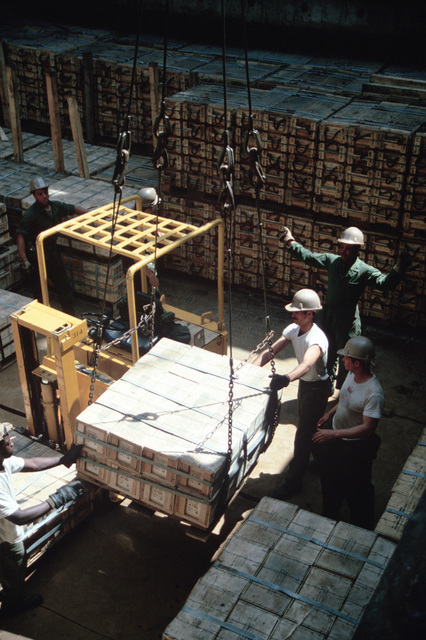 Members of the 155th Transportation Company use a winch to unload pallets from the chartered Military Sealift Command cargo ship BUILDER (T-AK 2031) during LIFELINE Operations