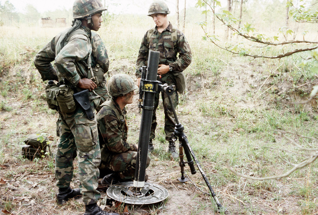 Members of the 3rd Battalion, 2nd Marine Regiment, position an 81mm mortar at Tactical Landing Zone Eagle during Exercise Solid Shield '83