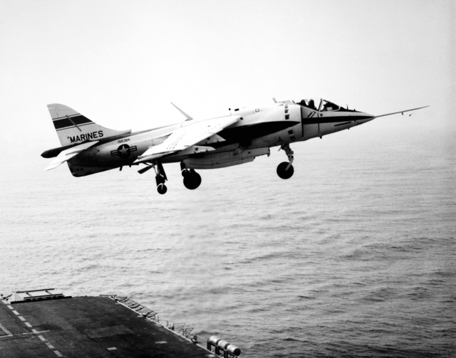 Right side view of an AV-8C Harrier vertical/short takeoff and landing (V/STOL) aircraft, just after takeoff from an aircraft carrier. The Harrier, manufactured by McDonnell-Douglas, Inc., is undergoing a test and evaluation program
