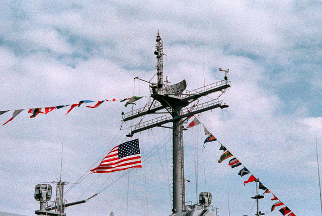 A view of the SPS-10 surface search radar aboard the tank landing ship USS LAMOURE COUNTY (LST-1194). The flag is being flown at half mast in tribute to Americans who lost their lives in the service of their country