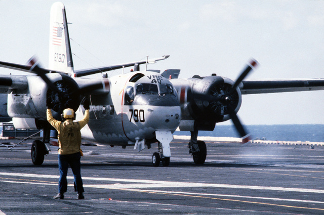 A front view of a Fleet Logistic Squadron 40 (VRC-40) C-1A Trader aircraft on the flight deck of the aircraft carrier USS AMERICA (CV 66)