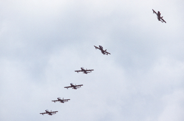 A ground-to-air view of six Aermacchi M.B. 339PAN aircraft, from the Italian Air Force Frecce Tricolori aerobic team, as they begin to break out of echelon formation during a demonstration