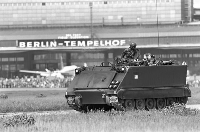 The United States Army provides rides in an M113 armored personnel carrier for children visiting the Tempelhof Central Airport Open House '83