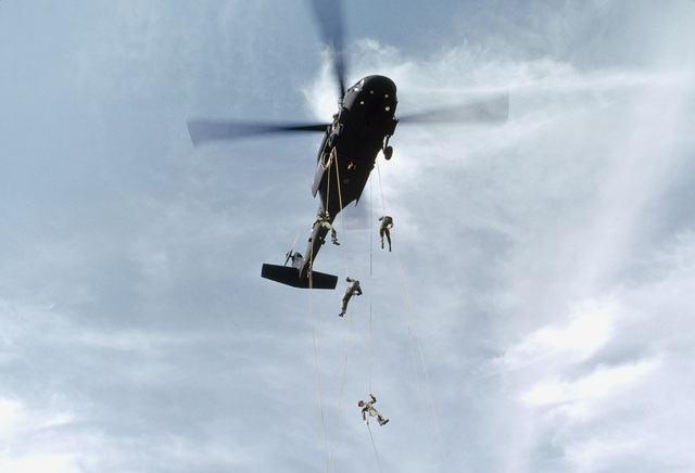Infantrymen are trained in rapelling from a UH-60 Blackhawk helicopter at the Army Air Assault School
