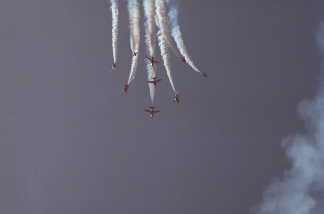 Nine British BAe Hawk aircraft of Canadian Red Arrows flight demonstration team in flight during an Open House Airshow