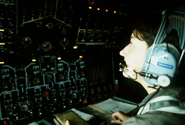 STAFF SGT. Denise Meunier checks the flight engineer's panel while en route to Andrews Air Force Base, Md., in a C-141 MEDEVAC aircraft. She is part of the first Air Force all-female flight crew to fly an overseas mission. They are returning to Andrews after flying the C-141 from McGuire Air Force Base, N.J., to Rhein-Main Air Base, West Germany, with a stop-over at Lajes Field, Azores