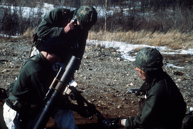 A mortar crew from Company A, 6th Battalion, 327th Infantry Regiment, prepares an 81 mm mortar for a live fire exercise during CELESTIAL EMPIRE '83