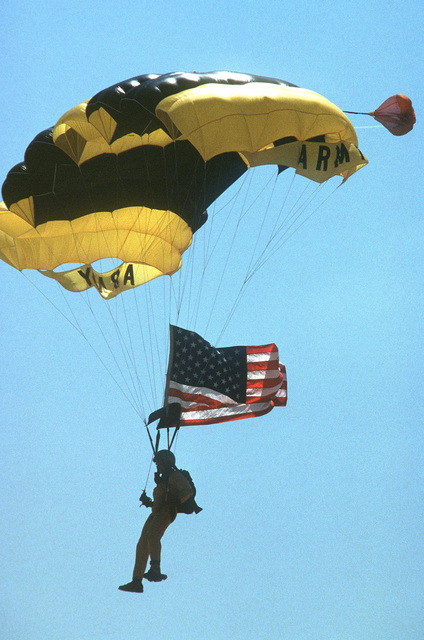 An Army paratrooper approaches the ground after a parachute drop at the Open House Air Show