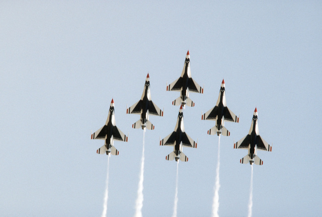 An underside view of F-16 Fighting Falcon aircraft assigned to the Thunderbirds flight demonstration team in a six-ship delta formation during the Open House Air Show