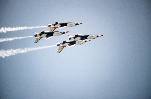Four F-16 Fighting Falcon aircraft assigned to the Thunderbirds flight demonstration team in as they fly in formation upside-down during the Open House Air Show