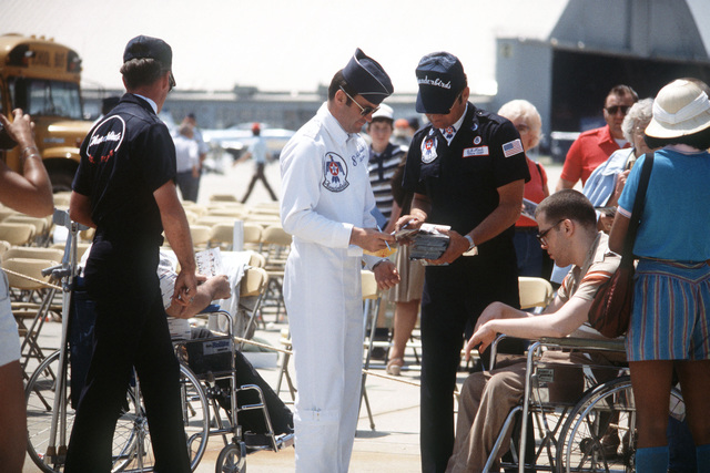 Members of the Air Force Thunderbirds flight demonstration team with some of the people attending the Open House Air Show