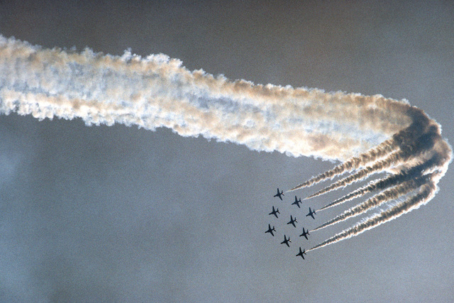 Nine Royal Air Force (British) BAe Hawk aircraft assigned to the Royal Air Force Red Arrows flight demonstration team, as they perform an areial stunt during the Open House Air Show